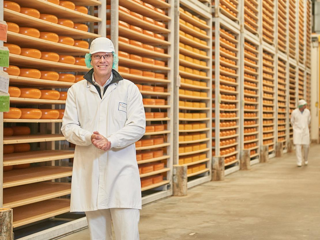 Employee in the cheese factory